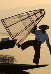 Catching fish on Inle Lake at sunrise (phuong.sg@gmail.com) Tags: agriculture asia attraction balance beautiful boat burma catch countryside culture dusk fisherman fishermen fishing inlay inle intha kayak lake landscape life local man morning myanmar nature net outdoor paddle reflection ripple river row rowing rural shan silhouette skill stand state sunrise sunset technique tourism tradition traditional trap travel water