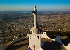 Aerial view of the Cristo Rei overlooking the city, Huila Province, Lubango, Angola (Eric Lafforgue) Tags: above aerialview africa angola angola180823 architecture art belief catholic christ christtheking christian christianity christorei colourimage cristorei day developingcountries dronepointofview elevatedview faith fulllength horizontal huilaprovince humanrepresentation jesuschrist lubango monument nopeople openarms outdoors portuguesecolony religion sculpture spirituality statue ao