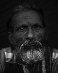 tired eyes (shravann93) Tags: nikon india chennai portrait koyembedu market expression face old blackandwhite black lowkey eyes tamilnadu streetphotography shravann93 nikond700 50mmf18