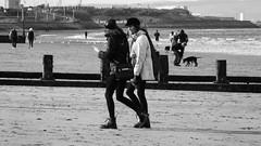 Autumn Afternoon at Portobello 014 (byronv2) Tags: sunny sunlight sunshine autumn portobello edinburgh edimbourg scotland coast coastal sea northsea firthofforth forth rnbforth river riverforth beach portobellobeach blackandwhite blackwhite bw monochrome peoplewatching candid stre woman gilr walking talking boots doctormartenboots