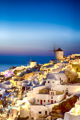 Traveling Concepts and Ideas. Picturesque View of Famous Old Town of Oia or Ia at Santorini Island in Greece. Picture Taken During Blue Hour with Traditional White Houses and Windmills At Dawn (DmitryMorgan) Tags: landscape aegean architecture aurora bluehour building caldera church cityscape destination dusk europe european famous greece greek hellenic historic holiday island iya landmark mediterranean mountain oia oya panoramic picturesque resort rock romantic santorini scenery sky slope summer summit sunlight sunny thera tourism town traditional traveling twilight view village volcano windmill