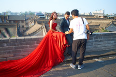 2018 Xi'an - On and Around the Old City Walls 87 (C & R Driver-Burgess) Tags: xian 西安 wall city towers ancient historical stone defense tourist bide groom wedding photographer marriage red train satin gauze posed suit bowtie tiara