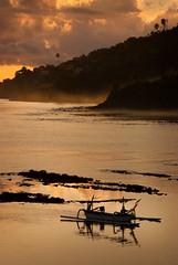 Amed, Bali Sunrise (EdBob) Tags: bali eastbali sunrise beach jukung boat fisherman fishingboat amed outrigger southeastasia village man sailboat asia indonesia indonesiantravel travel morning dawn fog clouds rocks shore shoreline 2008 edmundlowephotography edmundlowe asian allmyphotographsare©copyrightedandallrightsreservednoneofthesephotosmaybereproducedandorusedinanyformofpublicationprintortheinternetwithoutmywrittenpermission mackerel