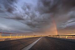 Towards the Rainbow (parkerbernd) Tags: rainbow towards road perspective rail clouds rain sunset dramatic light mont saintmichel france normandie