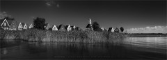Durgerdam B&W (Marijke M2011) Tags: panorama landscape water reed riet church woodenchurch dikehouses blue sky canonphotography markermeer marijkemooy