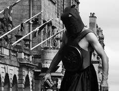 Fringe on the Mile 2018 0165 (byronv2) Tags: edinburgh edimbourg scotland royalmile oldtown peoplewatching candid street fringe edinburghfestival edinburghfestivalfringe edinburghfringe fringe2018 edinburghfringe2018 edinburghfestivalfringe2018 performer blackandwhite blackwhite bw monochrome man stilts giant hood costume helmet silence