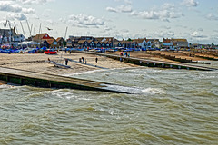Whitstable Beach (Geoff Henson) Tags: beach sea water waves tide ocean buildings sky clouds people bird gull boats yachts jetty slipway