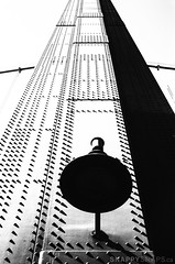 Stanchion-3 (Snappy_Snaps) Tags: red architecture architecturalphotography fineart lionsgatebridge vancouver stanchion bridge blackandwhite bw building skyscraper lines sky tower geometric