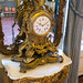 Gilded clock on wall table