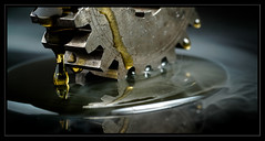 Gear in oil HMM (Nick M@tthews) Tags: beaulieu2speeddragracingbike cogwheel nickmatthews reflection smokeandmirrors yellow amber drip dripping gear macro metal oil teeth micronikkor55mmf28 legacylens mondays macromondays