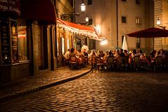 Järntorget (litrator) Tags: stockholm sweden sverige city old town light lightning evening night colors cozy cafe people eating orange dinner cobblestone street moment europe gamla stan