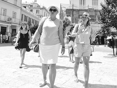 """By the Left, Quick, March...."" (markwilkins64) Tags: walking streetstory imposing summer sunglasses hats hat eyecontact ladies women females corfu corfutown greece markwilkins streetscene monochrome blackandwhite mono candid streetphotography street"
