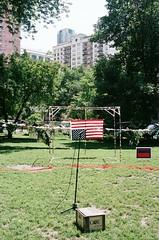 Upside Down Flag and Mic at Washington Square Park during Bughouse Debates 1 (shaundancekid) Tags: chicago bughousedebates washingtonsquarepark porta400 kodak nikon n65