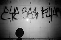 EYE SEA FL4UP (esmeelily) Tags: 35mm film analog lomo lomography grain ilford black white is dead urbex derelict abandoned building graffiti spraypaint street art vandalism tag tagging olympus trip af 50