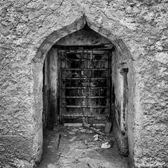 Mirbat Archway (Packing-Light) Tags: 120 6x45 mamiya6451000s analog film mediumformat kodak portra160 negative c41 reversal salalah oman middleeast mirbat entropy doorway portal door