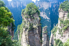 Mountain landscape of zhangjiajie national park, china (arnaud_martinez) Tags: china fairy high hill horizontal landscape nature peaks tree village yellow area asia autumn avatar beak beautiful bridge cave cliff column crag destinations film fog forest green hawk heaven hunan landmark lift mountain national natural outdoor pagodas province sandstone scenic space spear stone travel uprock valley wide wulingyuan yaozi zhangjiajie