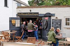 Beach Bar (Geoff Henson) Tags: beer wine porkscratchings crisps bar pub beachbar people customers barman barstaff table chairs eigns