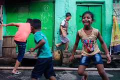 Fun time (SaumalyaGhosh.com) Tags: kids fun happy game play street streetphotography xt2 fuji fujifilm india kolkata colour color children girl smile enjoyment joy