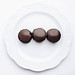 Top view of chocolate covered turkish dessert. Halva. White background