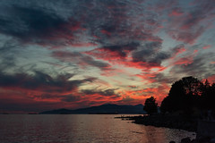 Red sky at night, shepherds' delight (armct) Tags: sunset red sky cloud wind spectators vancouver englishbay sunsetbeach evening calm serene blue reflection nightlights ships shore rocks peninsula silhouette
