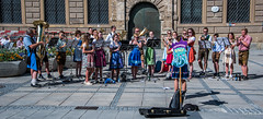 2018 - Germany - Munich - Marienplatz Musicians (Ted's photos - For Me & You) Tags: 2018 cropped germany munich münchen nikon nikond750 nikonfx tedmcgrath tedsphotos vignetting band entertainers streetscene horns trumpets trumpet shadows group people tuba widescreen musicians sax saxophone instruments playing players orchestra lederhosen legs