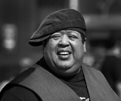 Sideways style with a smile (Frank Fullard) Tags: frankfullard fullard candid street portrait smile cap sideways style teeth fashion waistcoat monochrome black white blanc noir newyork manhattan us usa america