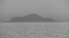 the lost isle of mists (byronv2) Tags: mist haar fog seamist coast coastal forth river riverforth firthofforth sea northsea weather rain water edinburgh edimbourg scotland island inch lighthouse geology blackandwhite blackwhite bw monochrome grey hazy landscape seascape