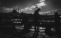 a fisherman in istanbul (tuncay demirbilek) Tags: fisherman galata sirkeci sky summer skyline sea sultanahmet street suleymaniye silhouette siluet süleymaniye sunset istanbul turkey türkiye turkiye shade shadow cami camii cloud camisi koprusu bridge