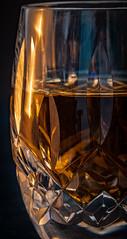Waterford Crystal Shot Glass (Jack Blackstone) Tags: lighting copyright 2018 em1markii glass macro macromondays waterford waterfordcrystal bourbon em1mkii candlelight blackbackground kentucky woodfordreserve slowshutter reflections crystal
