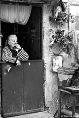 Smoke (Nino La Corte) Tags: blackwhite bw woman street photography smokes smoking religion home