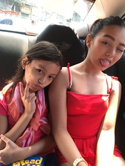 sister and I at the backseat of the car (ghostgirl_Annver) Tags: asian girl family sister siblings children child kid kids teenager preteen tongue happy naughty cute adorable happyplanet