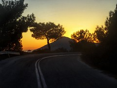A road trip to the sunset (panoskaralis) Tags: sunset sunsine sunrays sunlight sun orangesky trees pine road roadtrip view mountainview mountainside lesvos lesvosisland mytilene greece greek hellas hellenic outdoor landscape evening sonydschx60 sony