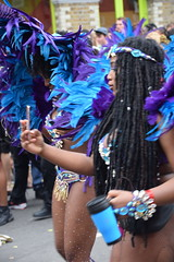 DSC_8388 Notting Hill Caribbean Carnival London Exotic Colourful Blue and Purple Costume with Ostrich Feather Headdress Girls Dancing Showgirl Performers Aug 27 2018 Stunning Ladies (photographer695) Tags: notting hill caribbean carnival london exotic colourful costume girls dancing showgirl performers aug 27 2018 stunning ladies blue purple with ostrich feather headdress braids