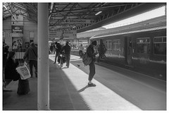Feeding the addiction (Nodding Pig) Tags: bristol templemeads railway station train england greatbritain uk 2018 passengers class150 dieselmultipleunit 1502 brel sprinter 150248 gwr greatwesternrailway film scan 35mm monochrome negative ilford fp4 nikonfm2 nikkor50mmlens 20180210037101border bri