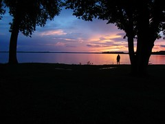 (AmyEAnderson) Tags: madison wisconsin outdoor marina storm sky pink blue grass trees sunset fisherman man person fishing lake mendota water waterfront canopy symmetrical