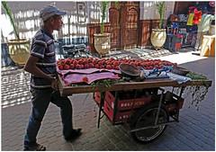 Peach Seller - Marrakesh, Morocco (TravelsWithDan) Tags: candid street peaches cart peachseller marrakesh morocco africa man urban city canong3x
