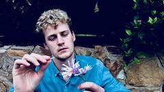 He loves me. He Loves me not (Beaux Coller) Tags: jessebauxvancoller photography boy guy blonde portrait artsy flowers hands