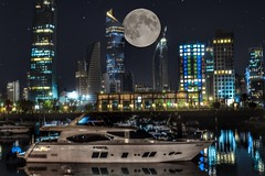 I spent a lot of time waiting until the moon appeared behind these tall buildings. Shoot the Moon scene with a 70-300mm lens. (basem_teacher) Tags: moments view scenery scene inexplore explore adventure trip landscape lightroom photographer photography 70300mm 50mm d850 nikond850 nikonphotography night moon moonlight sea seaside gulf arabian kuwait kuwaitcity