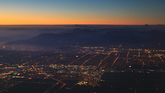 The Lights of Vancouver (fksr) Tags: vancouver britishcolumbia canada citylights burrardinlet water mountains pacificcoast cityscape landscape sky dusk evening horizon ships aerial