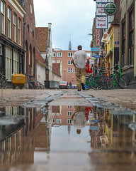 #ReflectionsByColors The Man With The Bag (30-08-2018) by #MrOfColorsPhotography #PortfolioOfColors #InspireMediaGroningen (mrofcolorsphotography) Tags: canonnederland canon canonphotography canon80d mrofcolors mrofcolorsphotography journeyofcolors journey photooftheday photographer photography photo photos city cityphotography cityphotographer day daytime daylight fotografie foto groningen reflection reflections portfoliofocolors dillenvandermolen instagram instagood inspiremedia inspiremediagroningen inspiremedgroningen water rain wet thenetherlands netherlands holland dutch colorful colour colourful colours streetphotography street streetphotographer streets