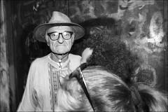 (The Grandfather of Voodoo) (Robbie McIntosh) Tags: leicam9p leica m9p rangefinder streetphotography 35mm leicam autaut candid strangers leicaelmarit28mmf28iii elmarit28mmf28iii elmarit 28mm man woman flash shutterdrag draggingtheshutter blackandwhite monochrome bw religion napoli naples