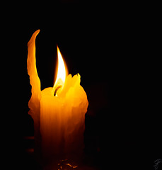 The light of the candle (Bela Bodo) Tags: memorial light yellow fire night nostalgia abstract christmas