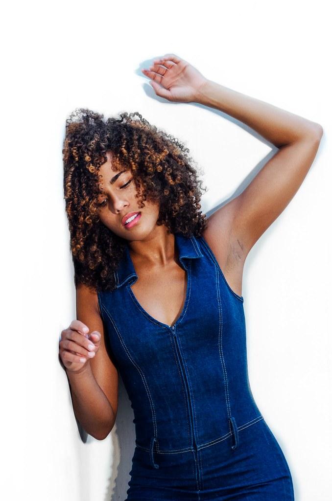 Curly ebony teen