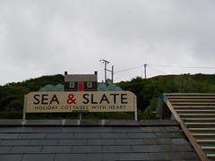 Llangrannog (Dubris) Tags: wales cymru ceredigion llangrannog seaside coast village sign sea slate cottage