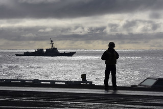 A Sailor stands on the flight deck of USS Harry S. Truman.