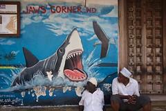 IMGP1289 Shark Attack (Claudio e Lucia Images around the world) Tags: stonetown zanzibar tanzania people man market pentax pentaxk3ii sigma sigma1020 pentaxart sigmaart street shark attack murale murales graffiti graffito streetart