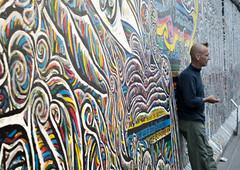 The wall (Alexandra Kfr) Tags: berlin wall colors man contrast yellow blue details urban germany