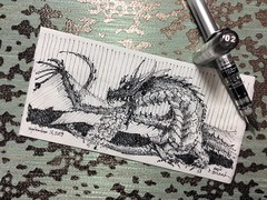 Awakening the beast (schunky_monkey) Tags: illustration art penandink ink pen fountainpen drawing draw sketching napkinsketch sketch napkin myth mythical mystery fantasy beast firebreather dragons dragon