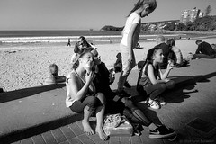 ice creams at the beach  #980 (lynnb's snaps) Tags: 35mm manly xtol bw blackandwhite film winter leicaiiif leicafilmphotography cv21mmf4colorskoparltm ilfordfp4 kodakxtoldeveloper manlybeach sydney australia coast 2018 street people children icecream ocean bianconegro blackwhite blancoynegro noiretblanc monochrome schwarzweis ishootfilm barnack