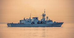 HMCS Vancouver (Paul Rioux) Tags: marine ship vessel warship frigate royalcanadiannavy navy naval military hmcs vancouver morning sunrise dawn smoke haze orange victoria bc calm water ocean sea prioux